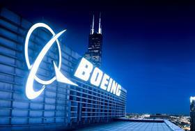 Boeing CFO Smith to retire, Boeing board ups retirement age for CEO Calhoun