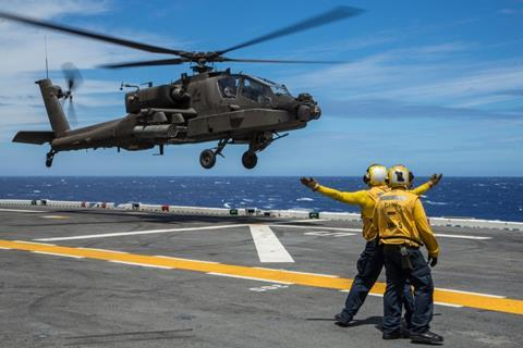 AH-64E landing qualifications on USS Peleliu c US Navy
