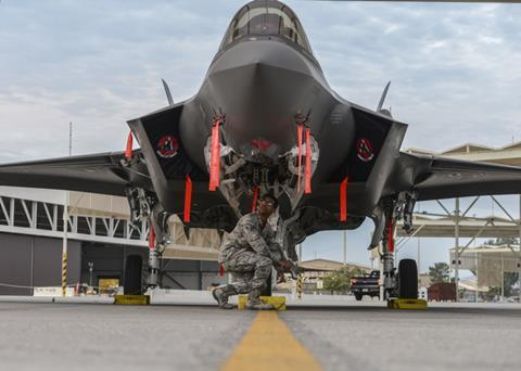 Crew chief performs an inspection on an F-35A Lightning II at Luke Air Force Base