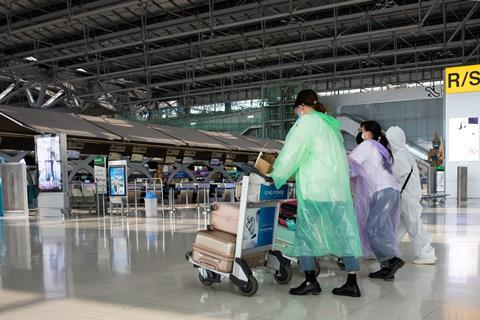 Passengers traveling through Bangkok airport June 19