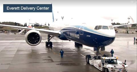Boeing's 777X test aircraft taxis for first flight at Paine Field.