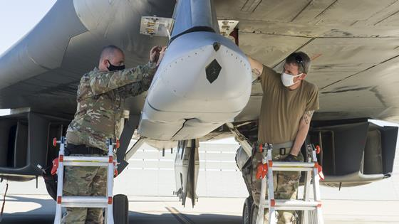 A weapon Loader crew uploads a Joint Air-to-Surface Standoff Missile to an external pylon on a B-1B Lancer c USAF